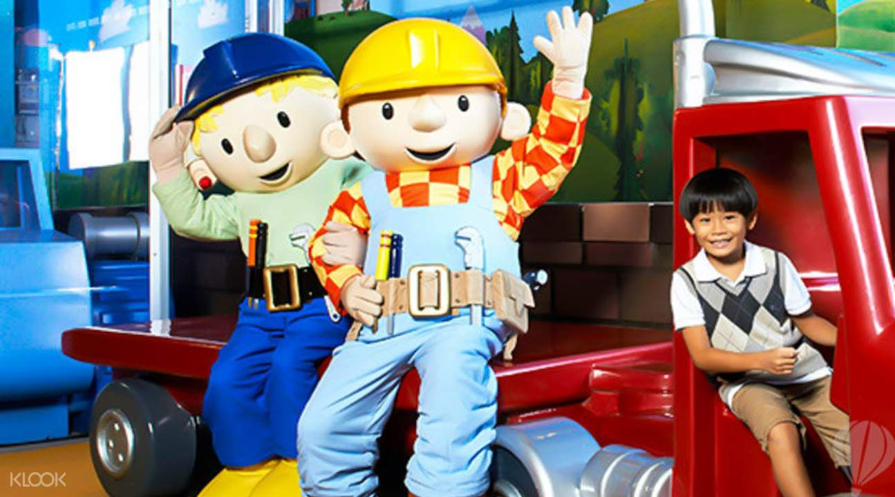 kid with bob the builder crew